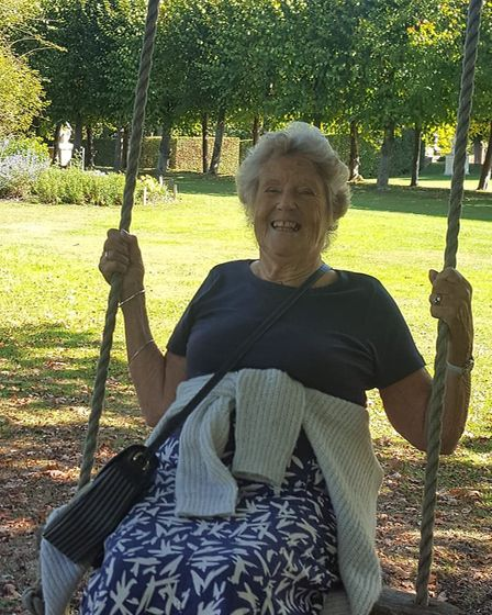 Enid Denchfield, 83, who lives at Margaret House care home, enjoys a go on the tree swing at St Paul