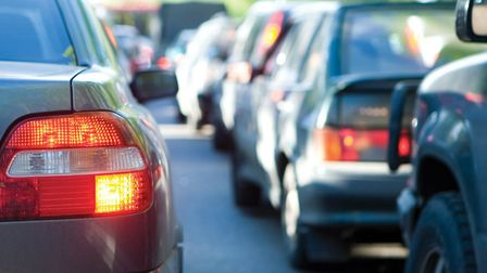 Traffic is slow on the A1(M) northbound after a crash that has left a car on its roof in a verge