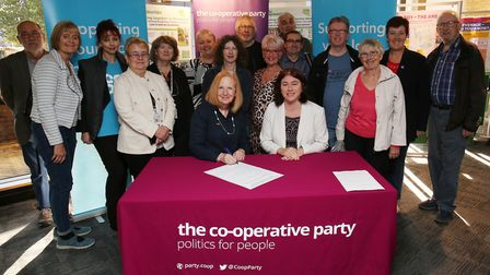 Stevenage council leader councillor Sharon Taylor and MEP Alex Mayer sign the Charter Against Modern