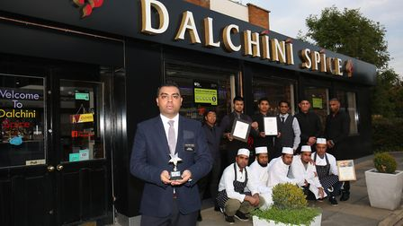 Manager Sumon Chowdhury with his team at Dalchini Spice in Shefford who have won several awards. Pic