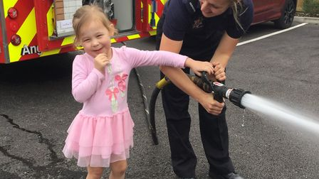 Children got to use the water hose to put out an imaginary fire. Picture: Chloe Hardy