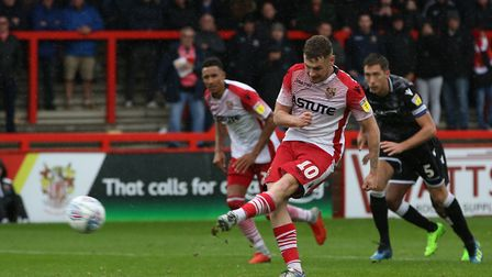 Ben Kennedy of Stevenage scores a penalty after Steve Seddon was fouled in the box in the League Two