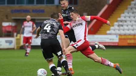 Steve Seddon of Stevenage runs at the defence and gets a shot on goal in the League Two game between