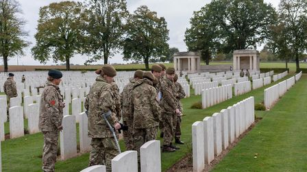 Bedfordhsire and Hertfordshire Army Cadet Force at Delville Wood walking amongst the graves of falle