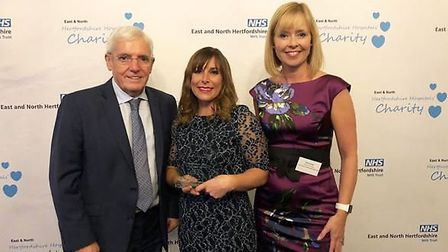 Midwife Denny Cody (centre) with the East and North Herts NHS Trust's director of strategy Kate Lanc