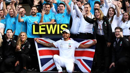 Lewis Hamilton celebrates with his Mercedes team. Picture: PA Wire