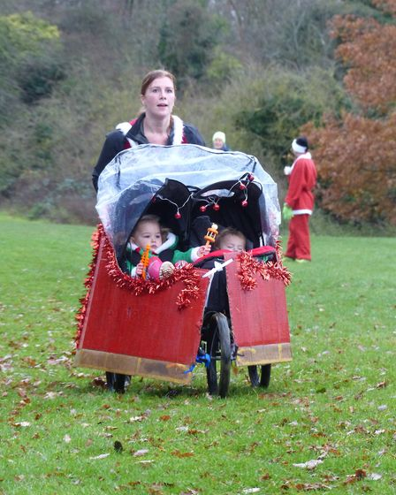 Letchworth Santa Canta 5k: Prize winner Jennie Freer wheeled her daughters Tilly and Erin around the