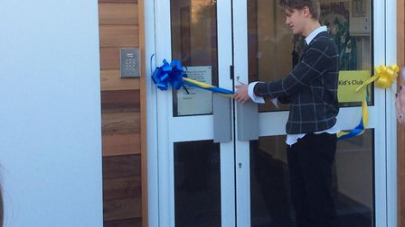 Former pupil George Smith cuts the ribbon to open the Maple Tree pre-school. Picture: Kim Varley