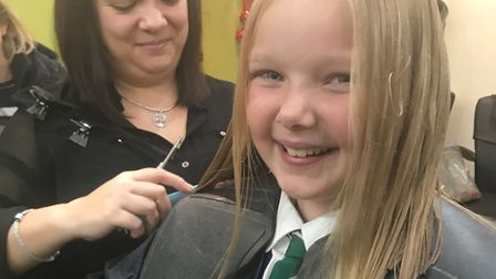 Tilly-Marie Pigram has had 13 inches chopped off her long locks for the Little Princess Trust. Pictu