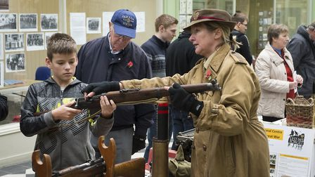 Denise Knight looking at memorabilia from World War I at the Herts at War Letchworth exhibition. Pi