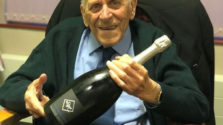 George Clark with a magnum of champagne to celebrate his 100th birthday. Picture: Fiona Field.