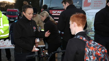 Stevenage fire station white watch hand out free bike lights as part of a new road safety initiative