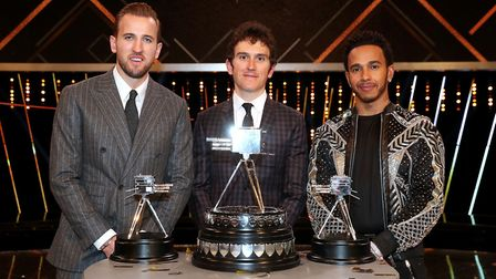 Geraint Thomas (centre) poses after winning the BBC Sports Personality of the Year award alongside t
