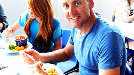 Golfer Ian Poulter, pictured enjoying his school lunch when returning to The Barclay School in 2013,