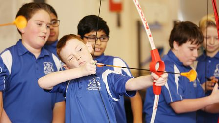 Luke from Super Star Sports coaches some year seven pupils in archery as part of the Barclay School
