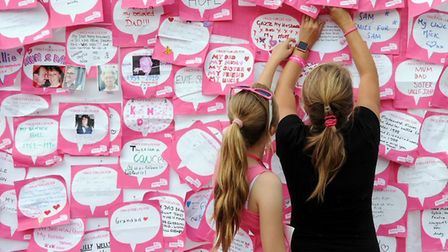 Handwritten dedications worn on participants' backs during Race for Life.