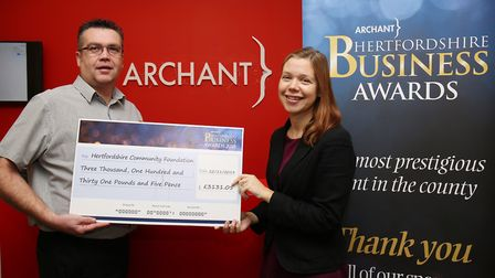 Archant event manager Joe Quinn presents a cheque to Hertfordshire Community Foundation director Hel