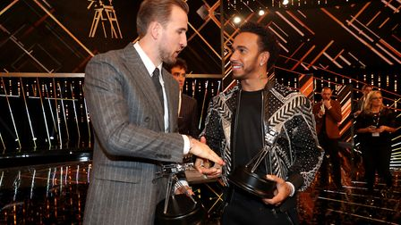 Third placed Harry Kane (left) and Second placed Lewis Hamilton shake hands after the BBC Sports Per
