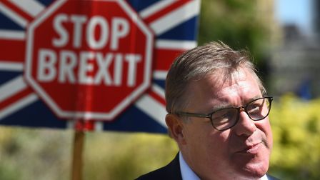 Conservative MP Mark Francois surrounded by anti-Brexit campaigners. Photograph: Kirsty O'Connor/PA.