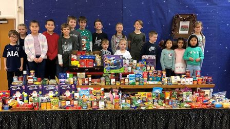 Pupils at Broom Barns School with some of the items donated through the reverse advent calendar. Pic