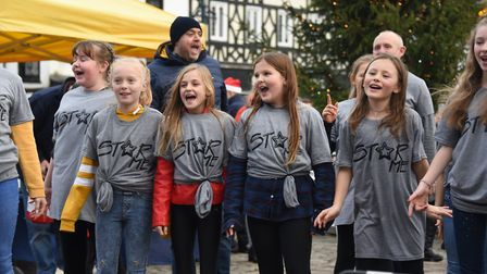 Tom Veasey was joined by more than 50 adults and children who sang Christmas songs to celebrate the
