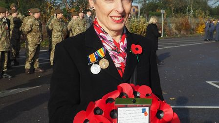 Sue Milliken with the wreath she laid at the Stevenage war memorial. Picture: Rosemarie Jenkins