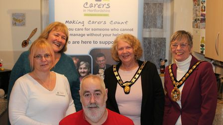 Les with his new look and, clockwise, friend Charmaine Terry, Carers in Hertfordshire chair Slava Bu