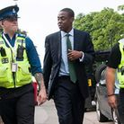 Bim Afolami shadowing a police officer and a police community support officer.
