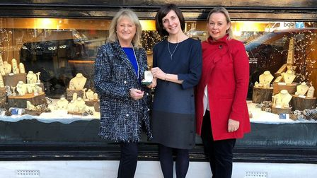 Charlotte Gatward (centre) presents Anne Kimpton with her pendant. Picture: Liz Marshall