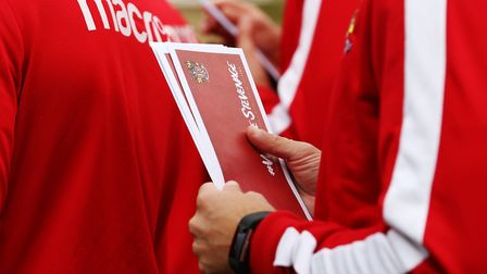 Stevenage FC players take to the streets of Stevenage to deliver some letters offering a special tic