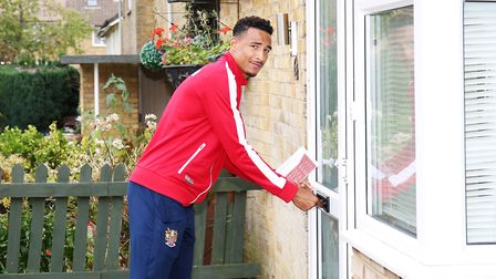 Kurtis Guthrie of Stevenage FC takes to the streets of Stevenage with other first team players to de
