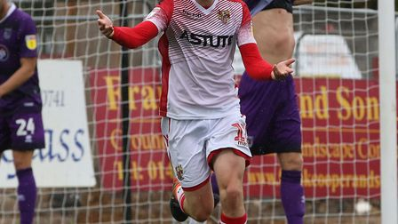 Steve Seddon of Stevenage celebrates after scoring the opening goal in the League Two game between S
