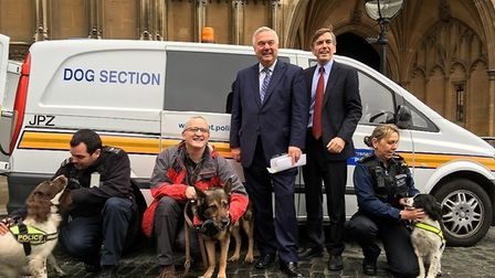 Police dog Finn and friends joined committee members at the Houses of Parliament as they voted on th