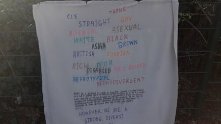 The t-shirt was removed from the Sappho statue, and this banner was placed on a fence nearby. Pictur
