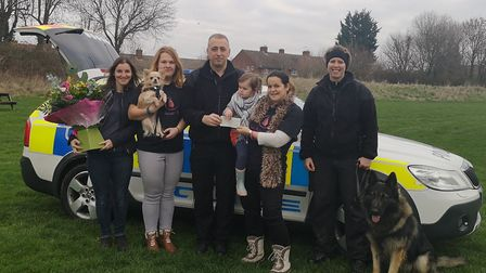 PC Lindsey Cox presents Natalie Howe with the cheque. Picture: Herts Police