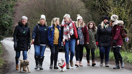 Joanne Mithchell with volunteers as they head off in search of her missing dog, Ernie. Picture: DANN