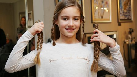 Honor Beverstock, nine, after having her hair cut. Picture: DANNY LOO