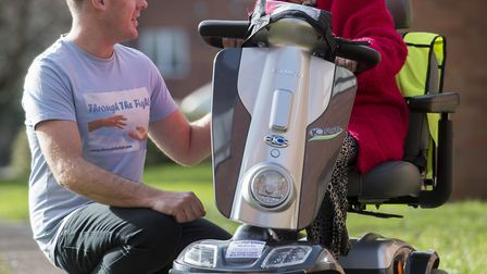 Molly Hutchings on her new scooter with Shane Yerrell. Picture: Triangle News