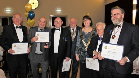 Rotarians receiving the Paul Harris Fellow medal and certificate at the celebration dinner. Picture: