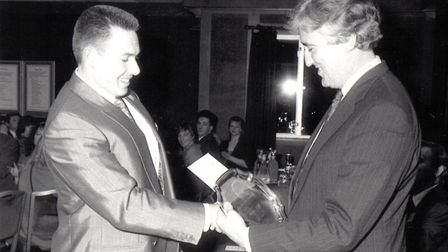 Lord Cobbold (right) presenting Rob Stewart with New Business Enterprise Award. Picture: The Comet