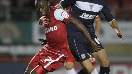 Michael Thalassitis battles with Leyton Orient's Moses Odubajo during his time at Boro's. Picture: J