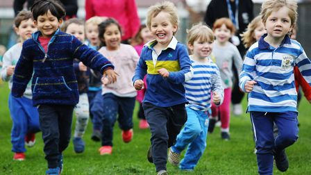 Staff and pupils at York Road Nursery take part in a charity run to raise money for Autism. Picture: