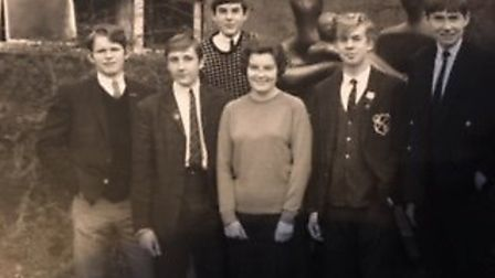 Former Barclay students with teacher Miss Phillips (centre) next to the Henry Moore sculpture. From