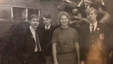 Former Barclay students with teacher Miss Camfield (centre) next to the Henry Moore sculpture. From