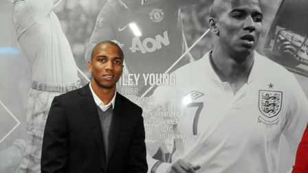 Footballer Ashley Young in front of his 2014 Hall of Fame image.