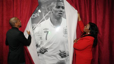 Footballer Ashley Young and then Stevenage mayor Sherma Batson unveil the final image in the 2014 Ha