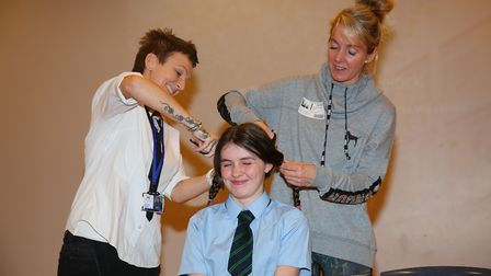 Mel Switters and auntie Andie Zealand cut Keira Switters, 13, hair as she raises money for Teenage C