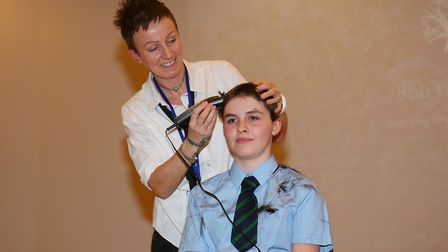 Mel Switters cuts Keira Switters, 13, hair as she raises money for Teenage Cancer Trust and the Litt