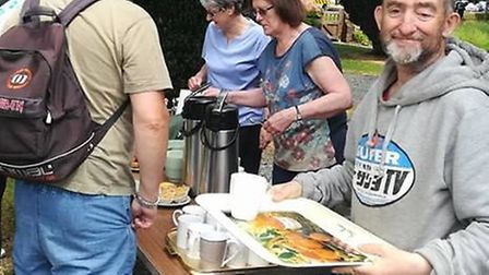 Chris O'Sullivan handed out refreshments to spectators of the Tour Series cycle race in Stevenage la
