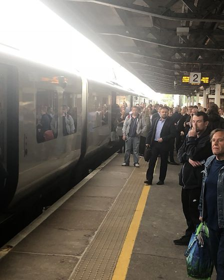 The scene at Hitchin railway station last May when fed up passengers staged a mutiny - standing in t